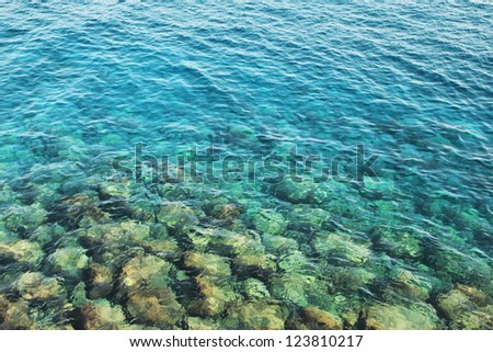 Reefs in transparent azure water