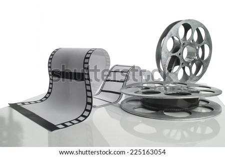 Reel and strip of  film on white background - stock photo
