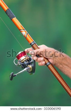 Reel of cane fisherman with fingers ruined