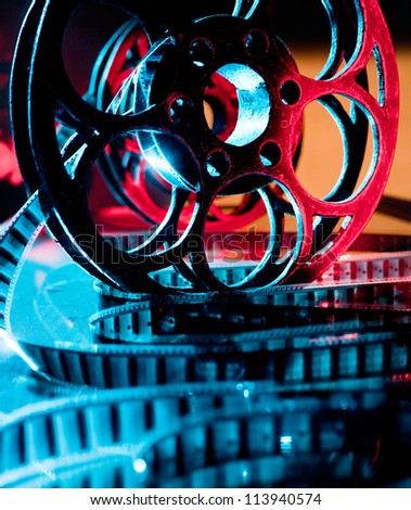Reel of film in bright light - stock photo
