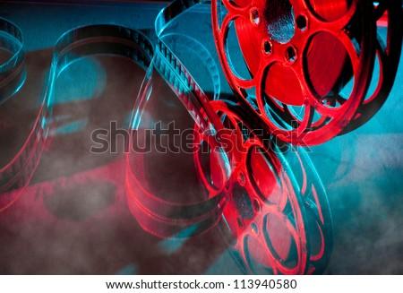 Reel of film in bright light - stock photo