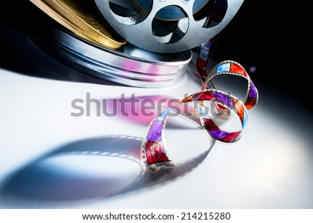 Reel of film on a color background - stock photo