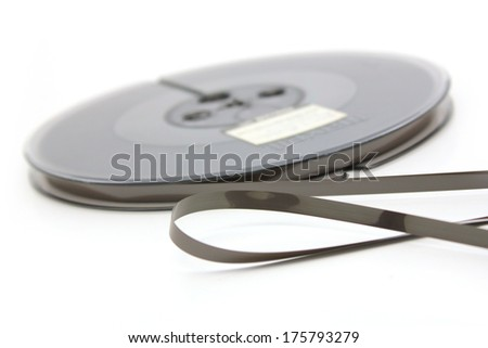 Reel-to-reel recording tape over white background