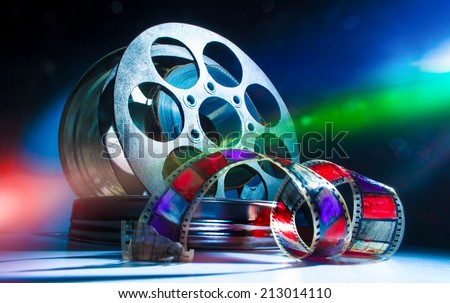 Reel with cinematic film - stock photo