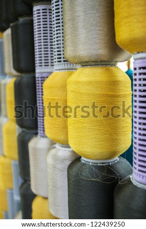 Reels of silk threads background - stock photo