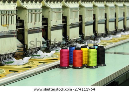 reels of thread with Machine embroider background