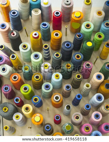 Reels of threads in tailor shop