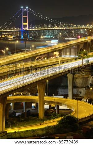 reeway and bridge at night - stock photo