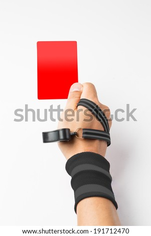 Referee hand and whistle show  Red card to player with white background - stock photo