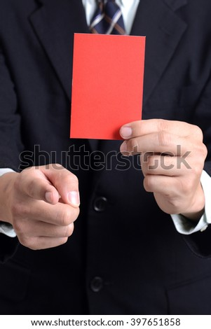 Referee hand showing red card for expelled  - stock photo
