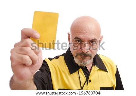 Referee show yellow card to the view - stock photo