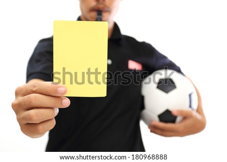 Referee showing a yellow card on white background  - stock photo