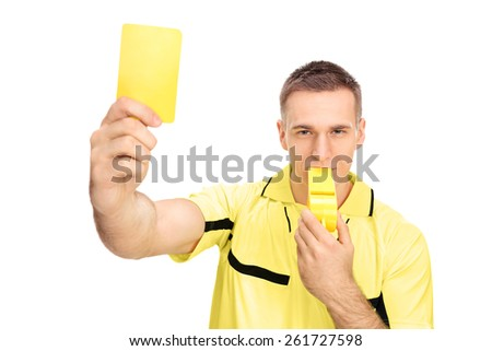 Referee showing yellow card and blowing huge whistle isolated on white background - stock photo