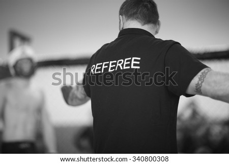 Referee stopping the fight - stock photo