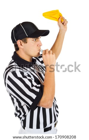 Referee: Throwing A Penalty Flag And Blowing Whistle - stock photo