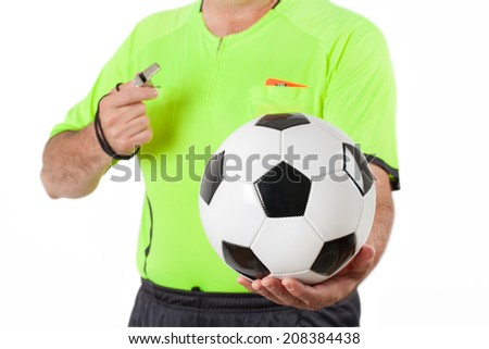 Referee with ball and whistle before the match - stock photo
