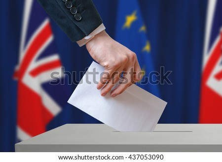 Referendum in Great Britain (Brexit) about relationship with European Union. Voter holds envelope in hand above ballot. - stock photo