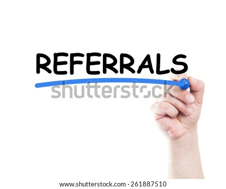 Referrals concept made by a human hand holding a marker on transparent wipe board - stock photo