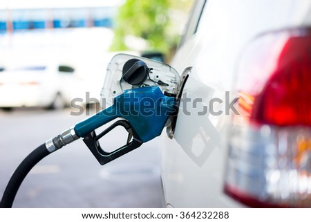 Refill fuel to a car at gas station - stock photo