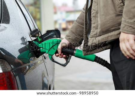 Refilling Car at Gas Station - stock photo