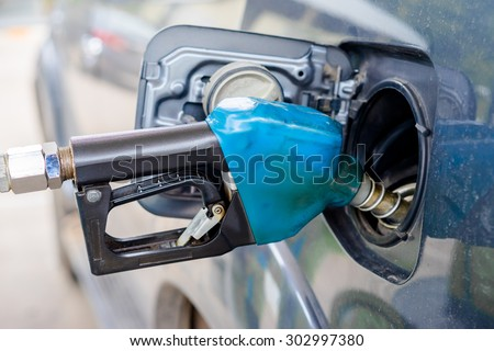 refilling the car with fuel - stock photo