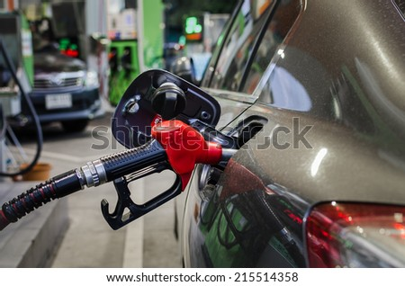 refilling the car with fuel on a filling station - stock photo