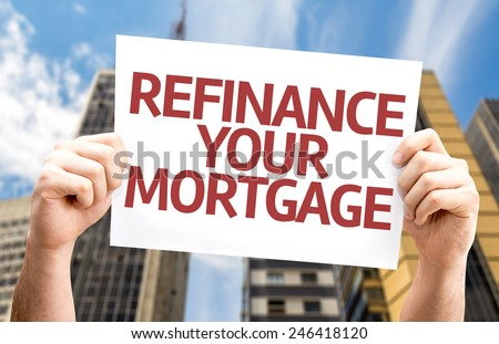 Refinance Your Mortgage card with a urban background - stock photo