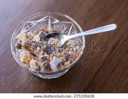 Refined brown sugar in crystal bowl - stock photo