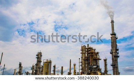 Refineries in Texas Toxic Petro Chemical Fossil Fuel Plants creating Pollution Creating Oil and Gasoline it is time to stop these Companies smog smoke rising  - stock photo