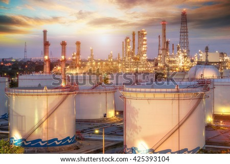 Refinery at sunset and oil thank petrochemical plant - stock photo