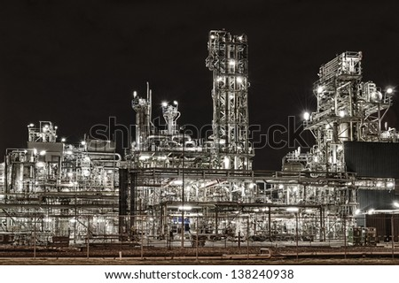 Refinery by night Rotterdam Europoort - stock photo