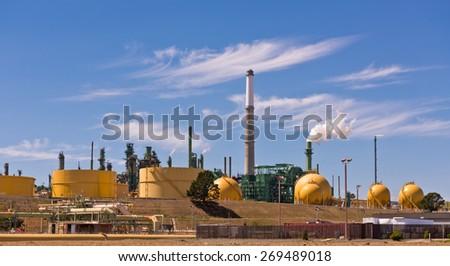Refinery Columns, Tanks, Distillation, Smoke, clouds and Sky - stock photo