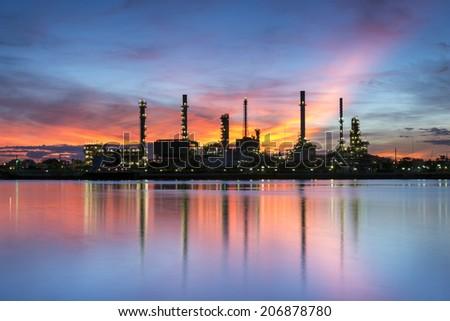 Refinery plant area at twilight siluate across the chao phraya River in Bangkok Thailand - stock photo