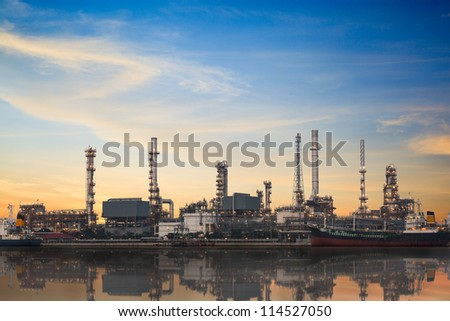 Refinery plant area at twilight with reflection - stock photo