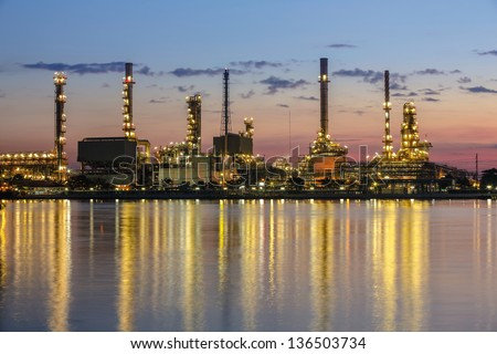 Refinery plant area at twilight with reflection