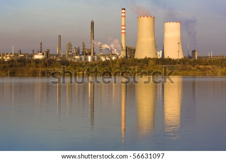 Refinery plant reflecting on the lake water