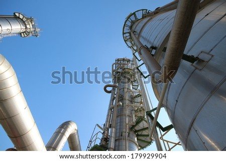 Refinery tower with blue sky