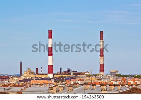 Refinery With Smoke Stacks - stock photo