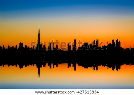 Reflect of silllhouette high rise buildings  in Dubai, UAE. The tallest building in the world
