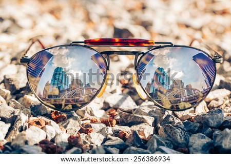 Reflected in sunglasses - stock photo