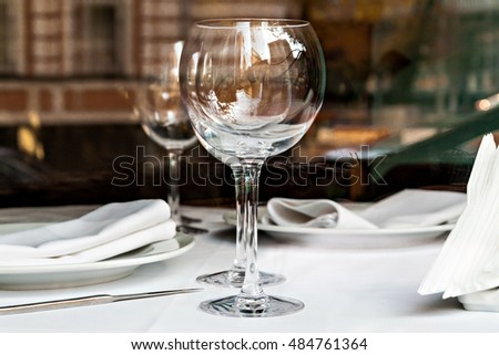 reflected in the empty glasses in a restaurant close upÃ??