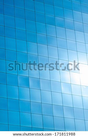 reflected in windows of modern office building - stock photo