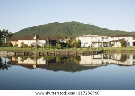 Reflected residential real estate. - stock photo