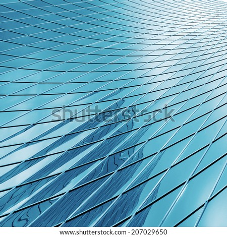 reflecting modern skyscraper glass - stock photo