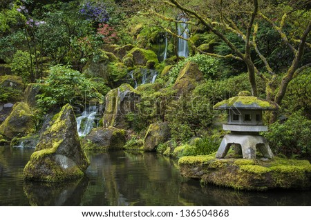 Reflecting pond in a Japanese garden - stock photo