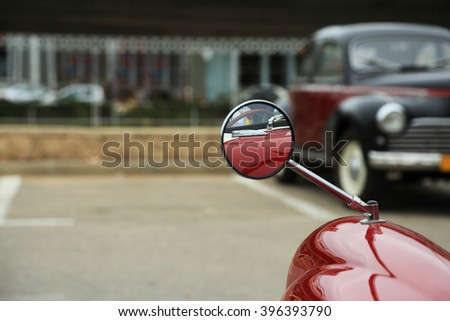 Reflection in a car mirror - stock photo