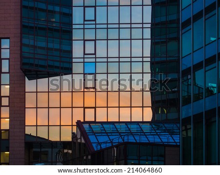Reflection in a glass facade of a skyscraper in Frankfurt, Germany. Office building in Frankfurt, Germany - stock photo