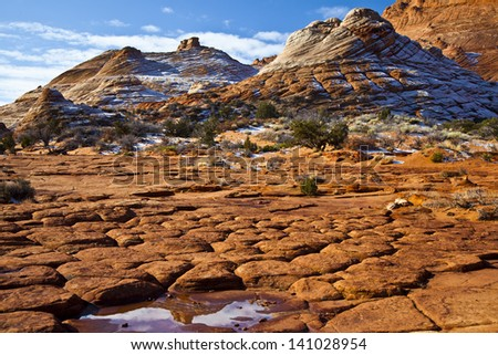 Reflection in a puddle in the red rocks - stock photo
