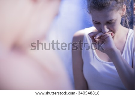 Reflection in mirror of teenage girl feeling sick  - stock photo