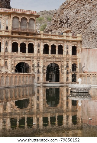 Reflection in pool of Hanuman Monkey temple outside India's Jaipur.